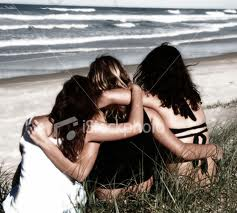 Friends Hugging on Beach